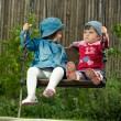 Two children on the swings in park — Stock Photo #2762328