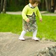 Stock Photo: Girl on the stone in park