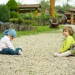 Stock Photo: Children playing with the stones