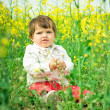 Beautiful child in canola field — Stock Photo #2762685