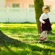 Royalty-Free Stock Photo: Little toddler girl playing on the park
