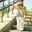 A little beautiful girl on a stairway — Stock Photo