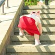 Stock Photo: Small child climbs stairs