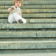 Girl sitting on a stairway — Stock Photo #2763361