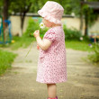 Little girl with a flower — Stock Photo