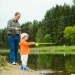 Stock Photo: Father with daughter fishing