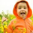 Beautiful child in canola field — Stock Photo