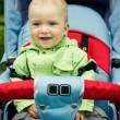 Beautiful child sitting in baby carriage — Stock Photo