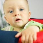 Beautiful baby on the swings portrait — Stock Photo #2763878