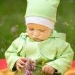 Baby with flower — Stock Photo