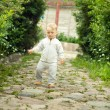 Little boy walks — Stock Photo