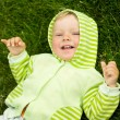 Funny boy on the grass — Stock Photo