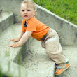 Little boy on a stairway — Stock Photo