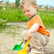 Stock Photo: Little boy in sandbox
