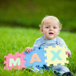 Boy holds puzzles with name Max — Stockfoto