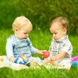 Two children playing in park - Stock Photo