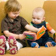 Boy and girl with the book - Stock Photo