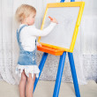 Royalty-Free Stock Photo: Girl draws on the board