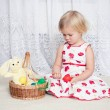 Girl plays easter eggs — Stock Photo
