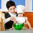 Stock Photo: Mother and daughter cooking