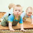 Children on the floor - Stock Photo