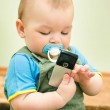 Baby playing with a cell phone — Stock Photo