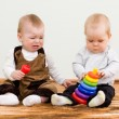Stock Photo: Two children shared a toy