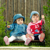 Two children on the swings — Stock Photo
