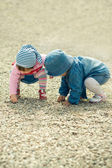 Children playing with the stones — Stock Photo