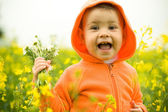 Beautiful child in canola field — Stock Photo
