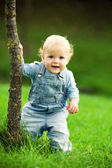 Little happy child near the tree — Stock Photo