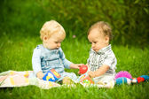 Two children playing in park — Stock Photo