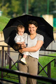 Mother with son under umbrella — Stock Photo