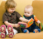 Boy and girl with the book — Stock Photo