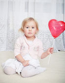 Girl with heart balloon — Stock Photo
