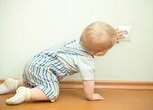 Child near the socket — Stock Photo