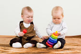 Two children shared a toy — Stock Photo