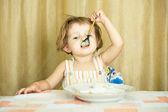 Little girl eats porridge — Stock Photo