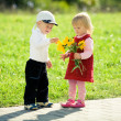 Children and flowers — Stock Photo