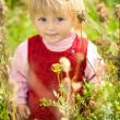 Little girl in grass — Stock Photo