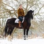 Girl riding a horse — Stock Photo #2784048