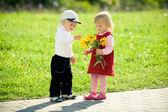 Children and flowers — Stock Photo