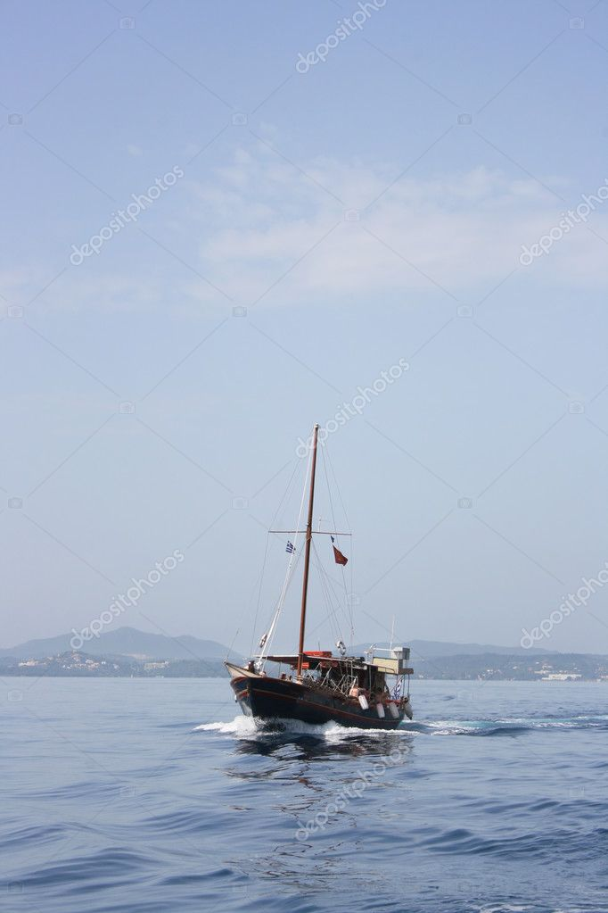 Little touristic boat cruise on blue sea near Corfu island — Stock Photo #3612459