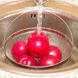 Red apples under current water — Stock Photo