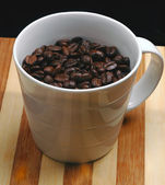 Coffee beans on a cup — Stock Photo