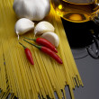 Pasta garlic extra virgin olive oil and red chili pepper - Stock Photo
