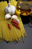 Pasta garlic extra virgin olive oil and red chili pepper — Stock Photo