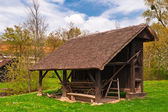 Farm cart under roof of rustic shed — Stock Photo