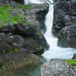 Small waterfall in black rocks. — Stock Photo #3125907