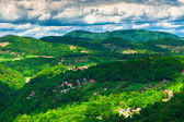 Dramatic clouds over green hills — Stock Photo